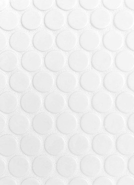 A closeup image of white penny tile used on the kitchen counter backsplash
