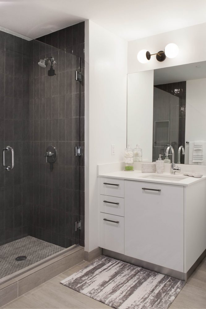 Our bathrooms feature frameless glass stand-up showers with tile.